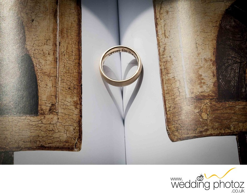 wedding ring band on book showing love symbol