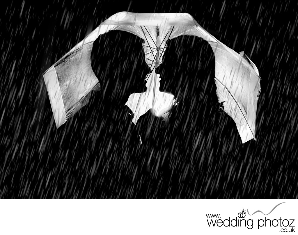 engaged couple in a silhouette in the rain