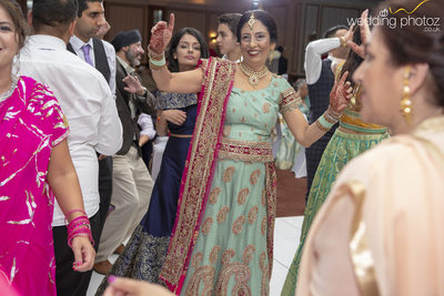 Groom's mother on the dance floor at Son's Wedding Reception
