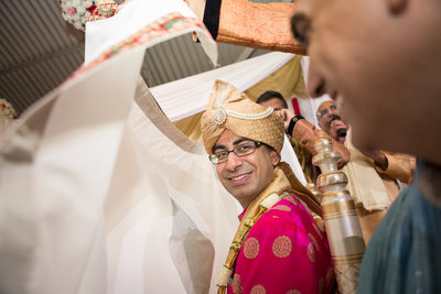 Indian Groom behind Antarpat at his traditional wedding
