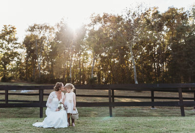 Bride with flower girl at Terian Farms