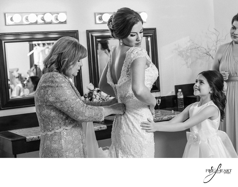 Bride with flower girl getting ready