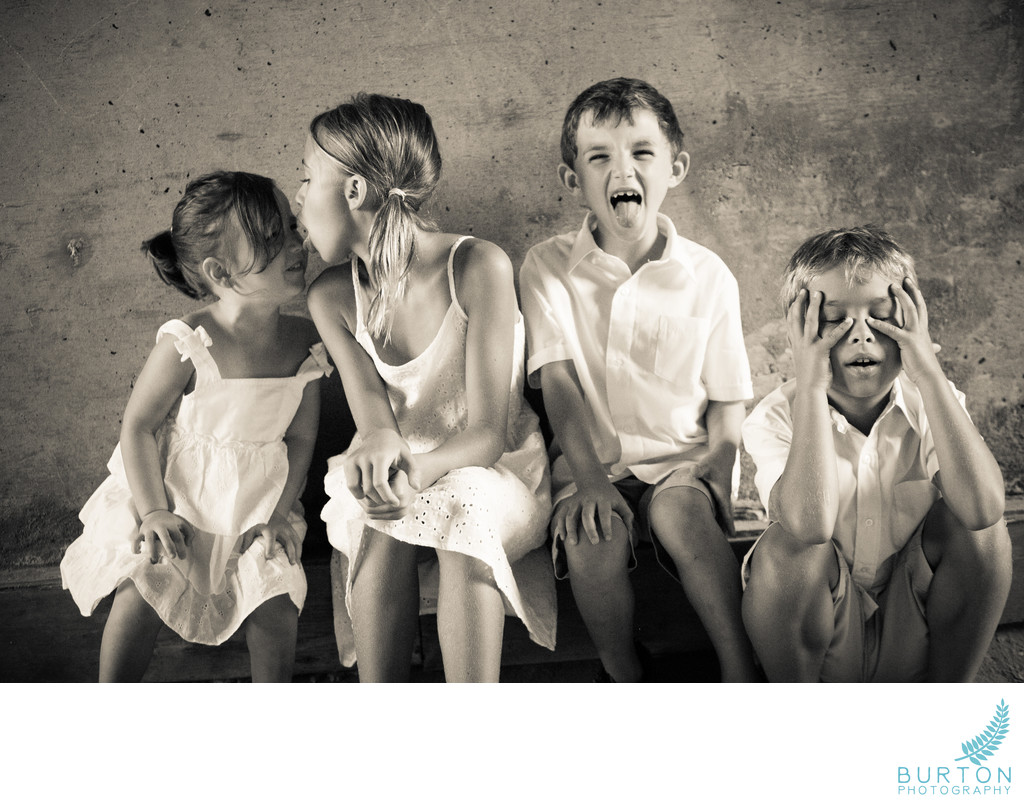 Funny Portrait of Children Blowing Rock