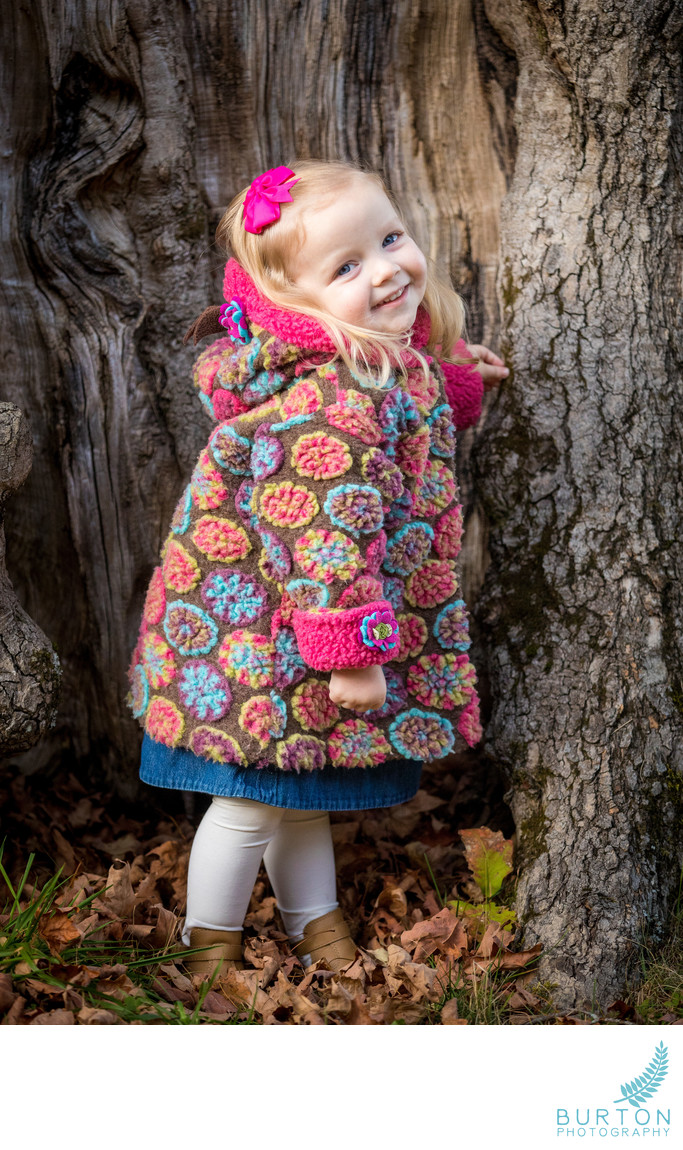 Winter Portrait of Girl in Whimsical Coat at Bass Lake