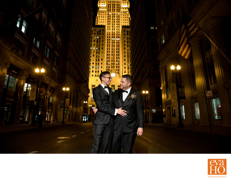 Gay Couple in Front of Chicago Board of Trade at Night