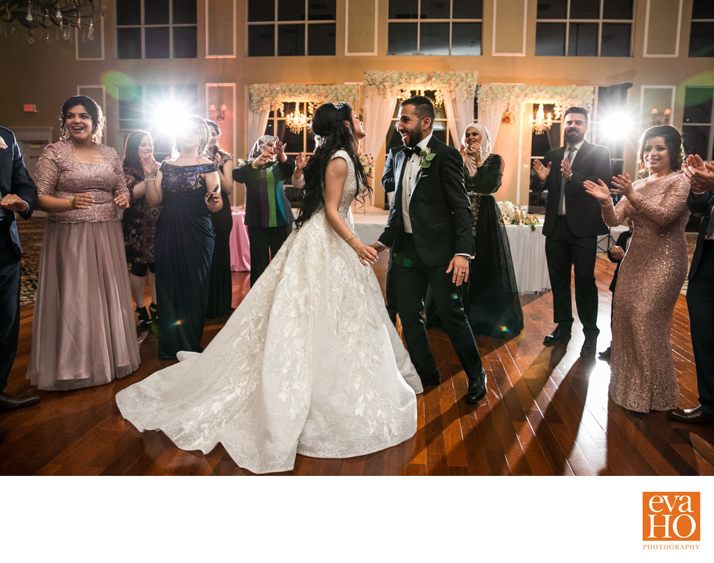 Bride and Groom dance among their guests at reception
