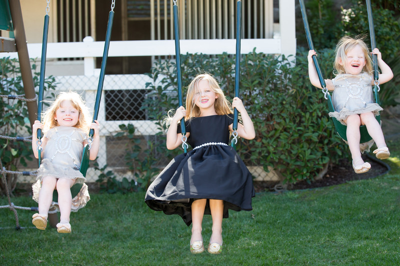 Beautiful Sisters Swinging and Laughing during Portrait Photography Session