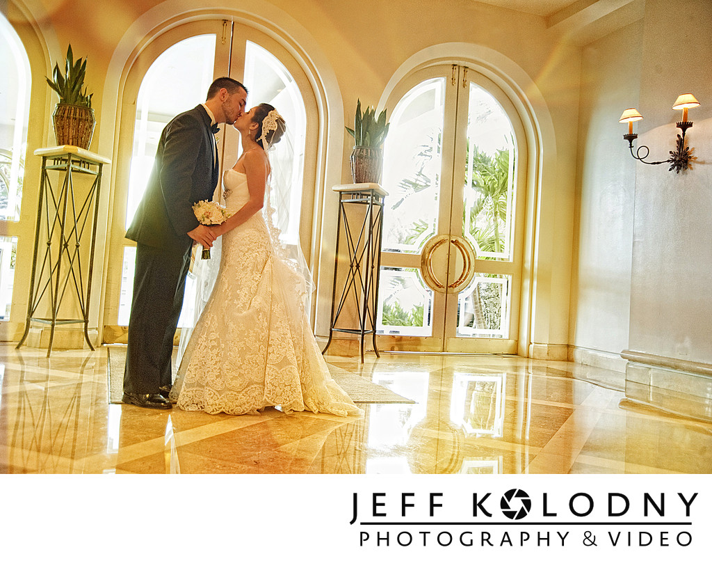 Bride and groom kiss at the Four Seasons