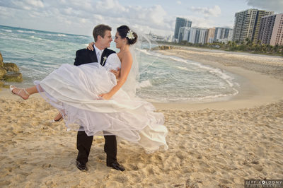 Bride and Groom kissing on the Beach at The Palms Hotel