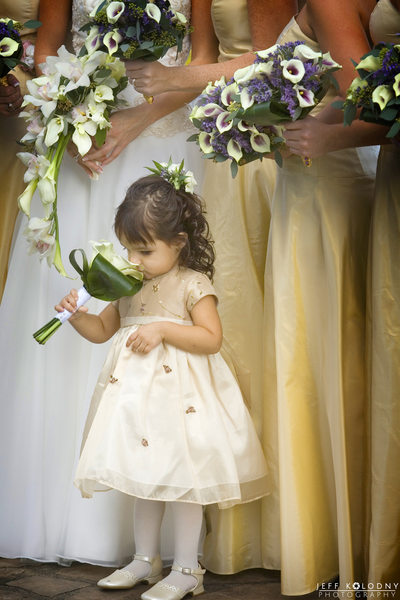 Flower girl smelling flowers at a South Florida wedding