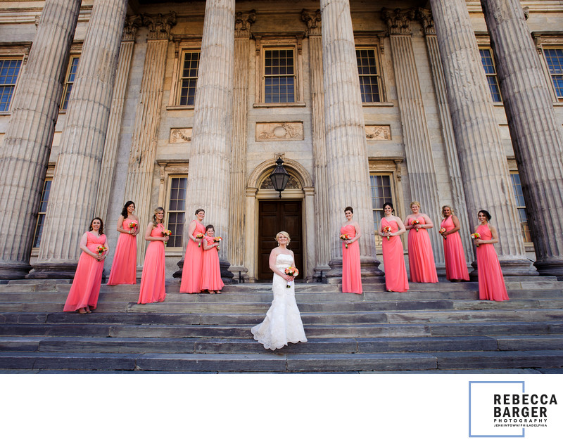 Coral bridesmaids, ionic columns and a lovely bride.