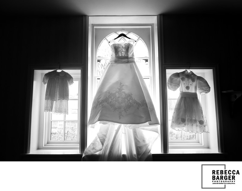 Passage of time in dresses.  Christening gown, wedding gown, confirmation gown.