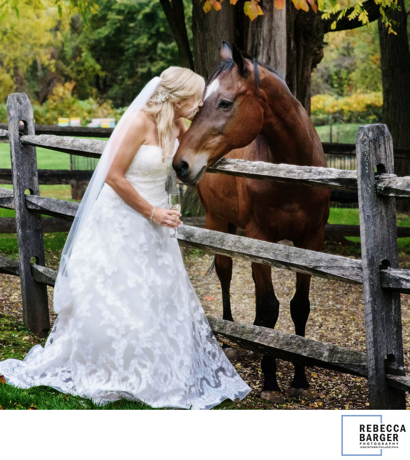A few horsey kisses outside the barn, on wedding day.
