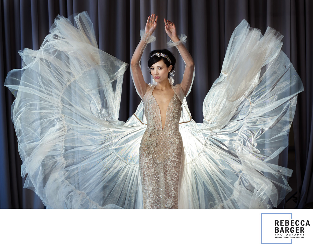 Mei and her angel wings Eden Aharon gown at  Moulin