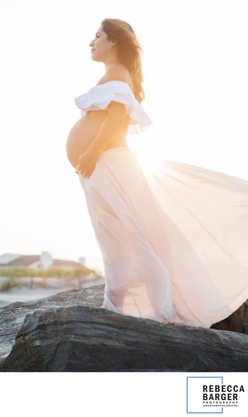Mother-to-be at sunset, on the Ocean City, NJ,  shoreline.