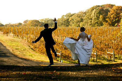 The bride word St. Pucchi and converse as she and her groom ran through the vineyard.