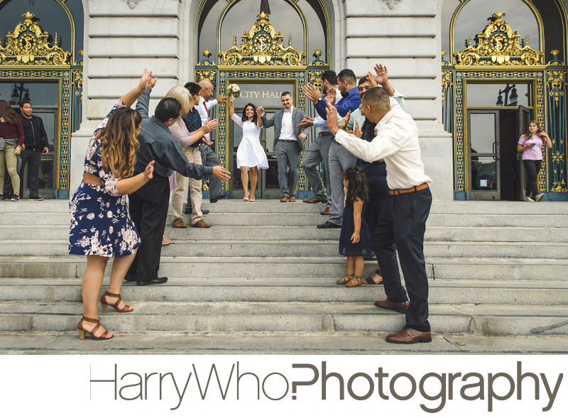 Fun couple exiiting the San Francisco City Hall Wedding
