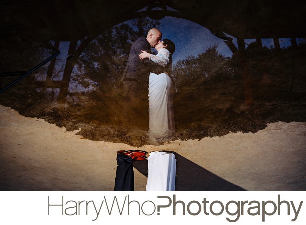 An image of water reflection of a couple married at Los Gatos Oak Meadow Park