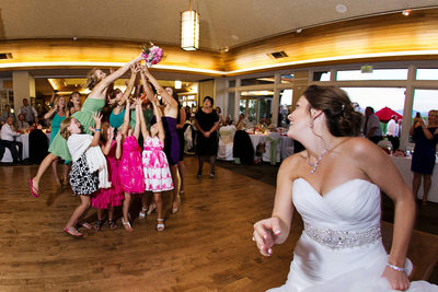 Wedding bouquet toss at Cinnabar Hills Golf Club