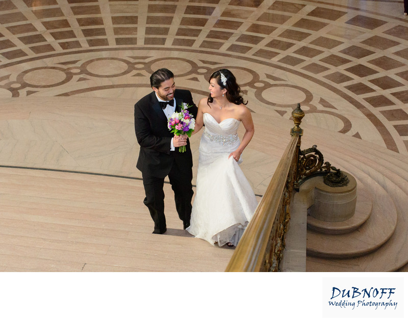 bride and groom work there way up the Grand Staircase