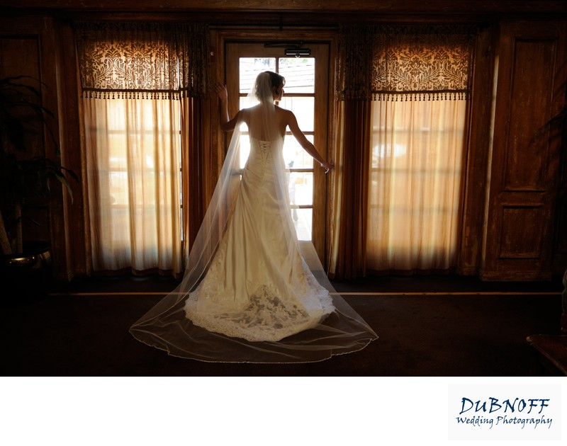 Wedding Photography image with bride under window