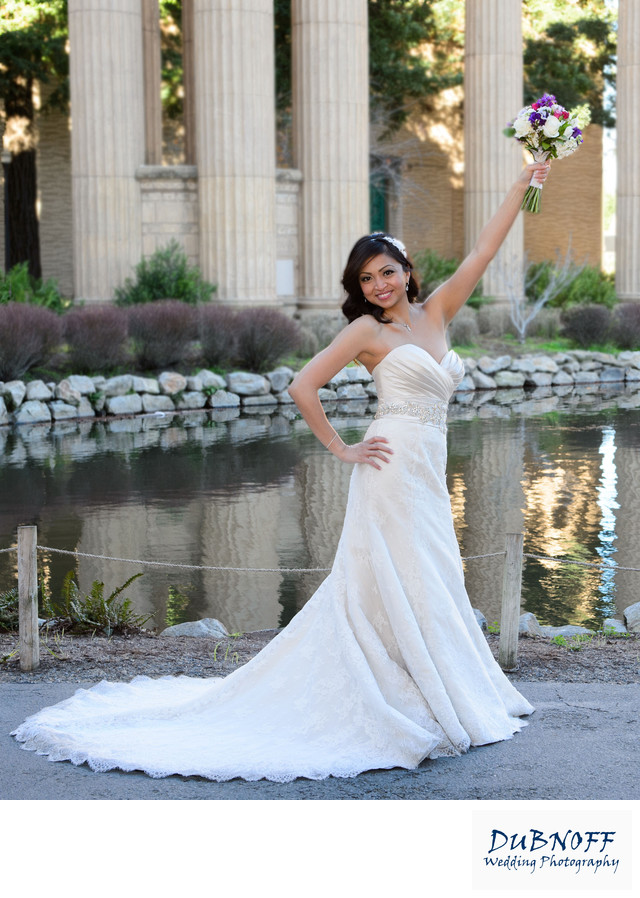 fun bride at palace of fine arts with flower bouquet