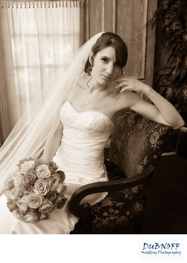bridal portrait sitting in a chair at the Blackhawk Country Club