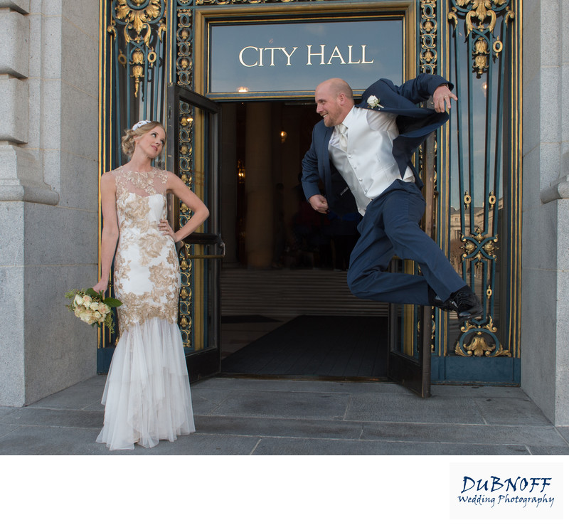 groom jumps in san francisco in front of City Hall