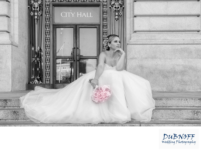 Beautiful bride waiting on the front steps of SF City Hall