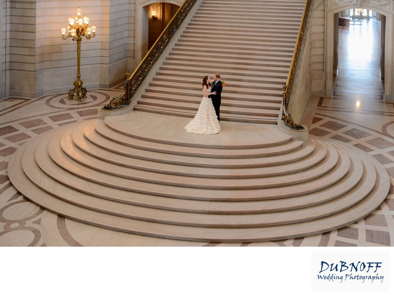 grand staircase sf city hall with Bride and Groom