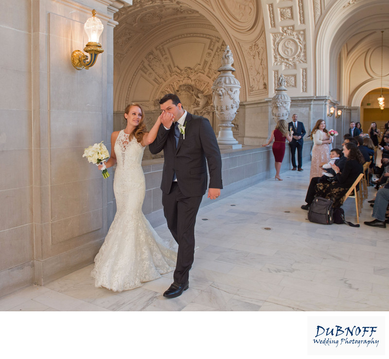 SF City Hall ceremony kiss, a candid wedding photography example