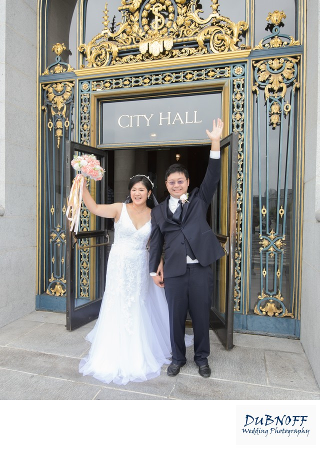 Newlyweds Celebrating as they Leave San Francisco City Hall