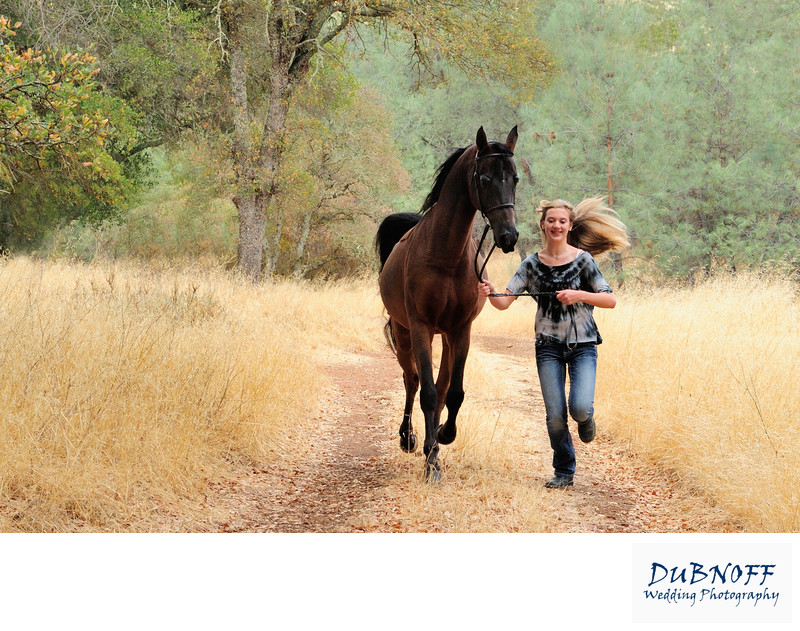 Girl Running with her horse during Equine Portrait Session