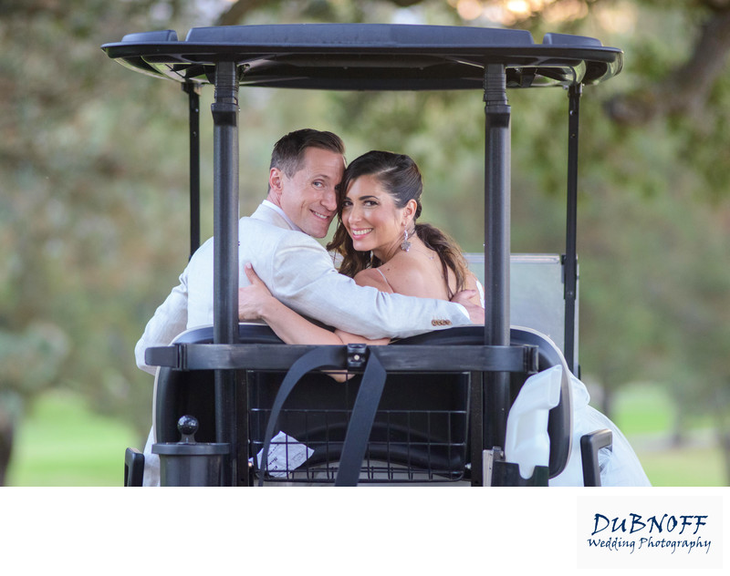 Boundary Oaks wedding - bride and groom in a Golf Cart