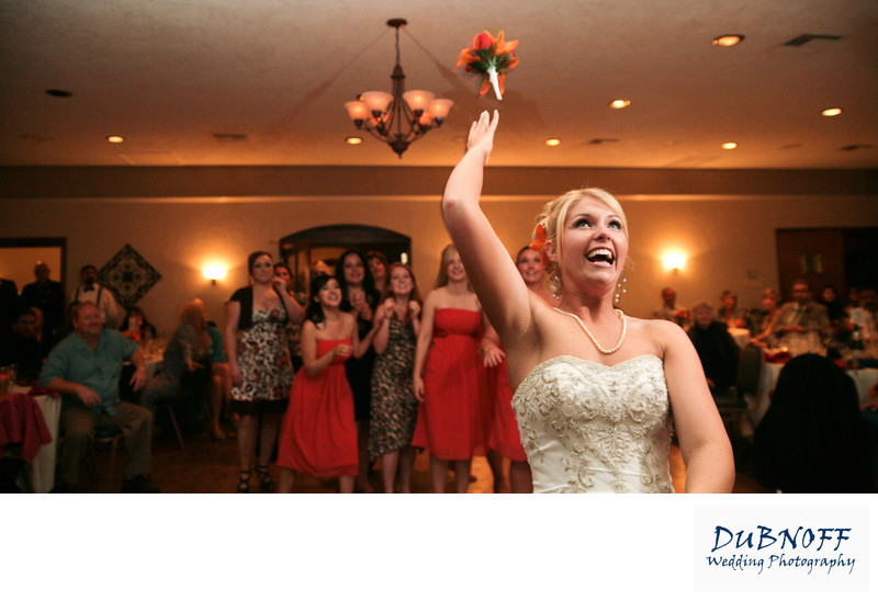 Bride throws her bouquet at the Contra Costa Country Club in Pleasant Hill, California
