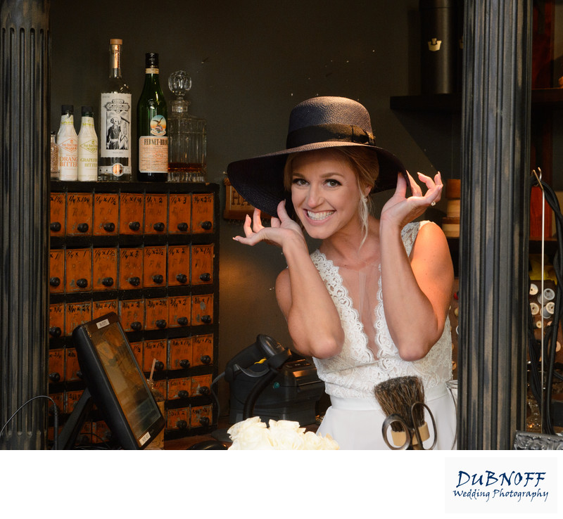 Cute picture of Bride posing with a hat on from North Beach in San Francisco