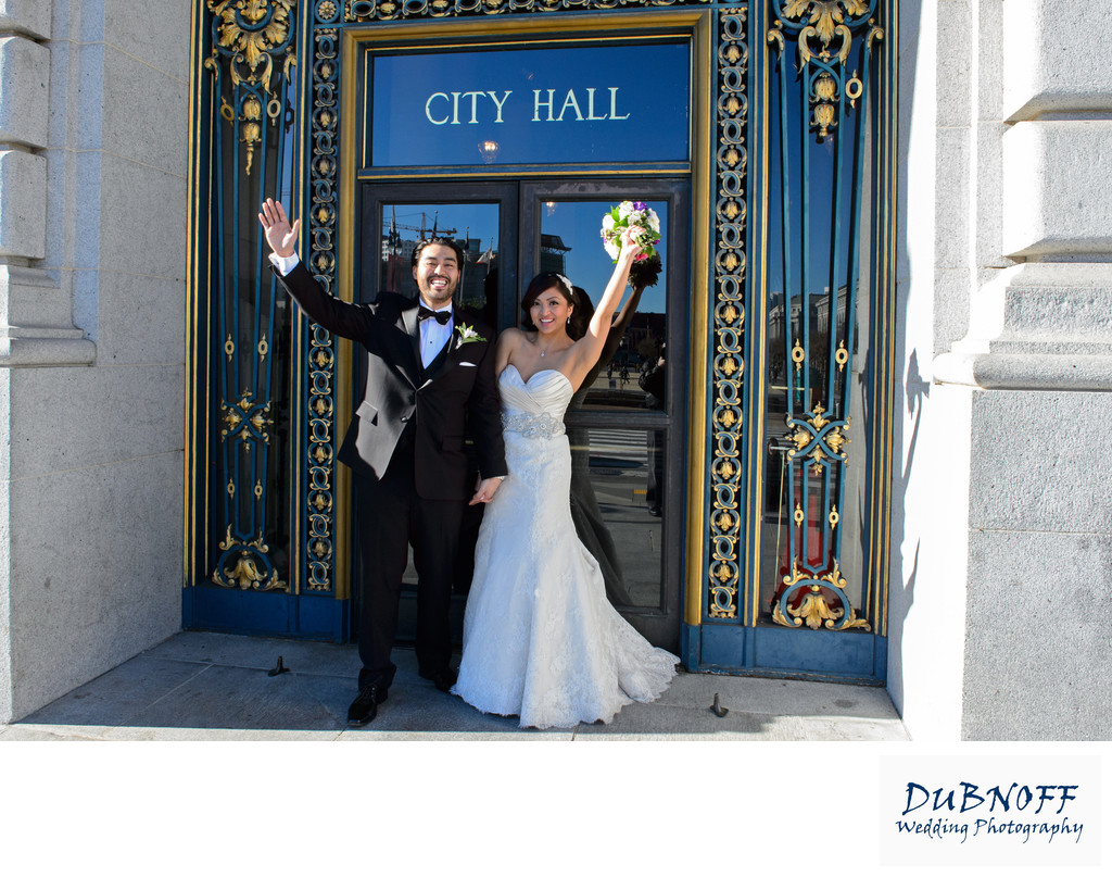 City Hall Sign  Bride and Groom Waving to photographer