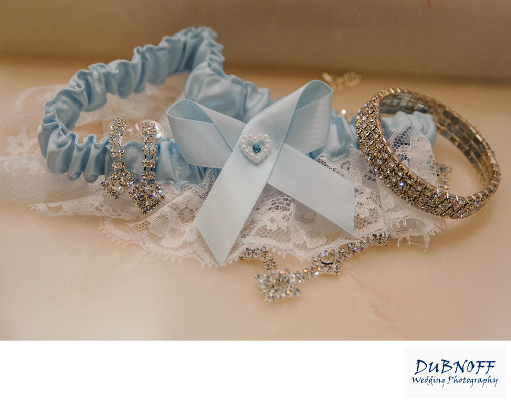 Wedding Details Image of Garter and Bride's Jewelry