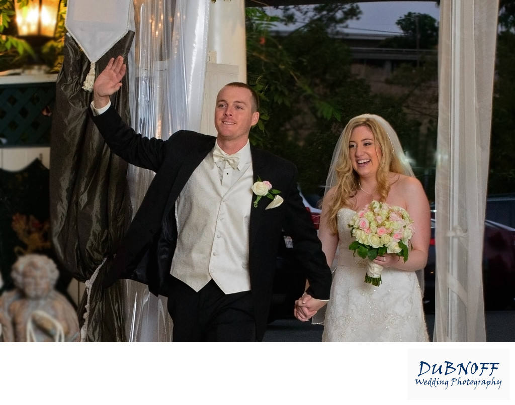 fun wedding reception entrance by bride and groom