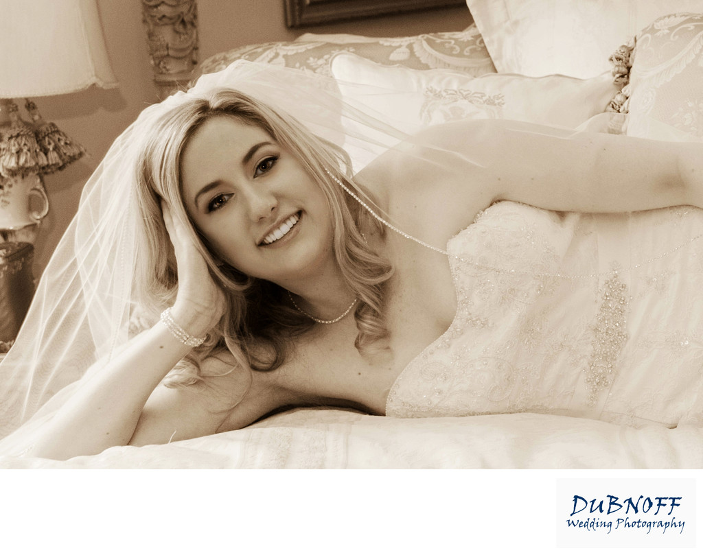 sepia bride across grand bed at Jefferson St. Mansion