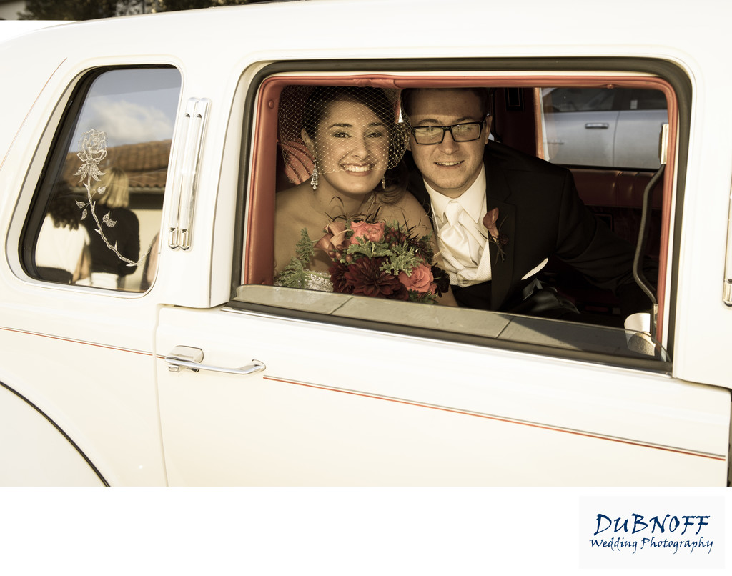 Bride and Groom in Limo heading to their Berkeley City Club Wedding Reception