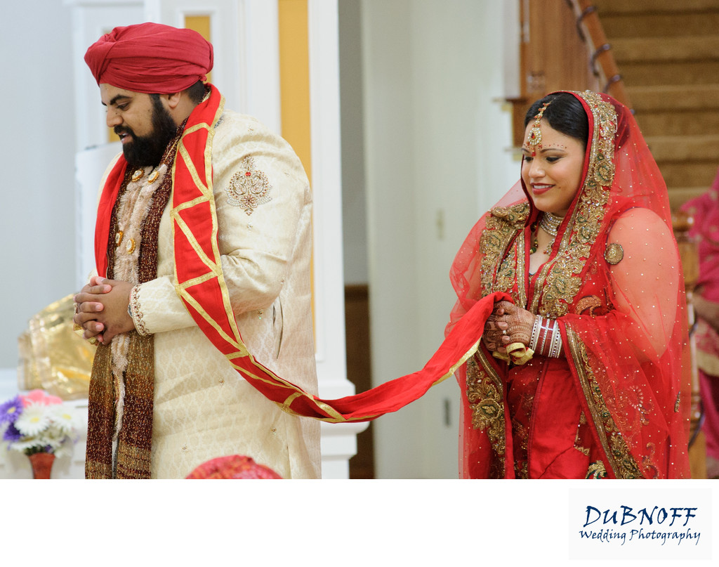 Sikh Wedding Ceremony bride and groom walking around the table