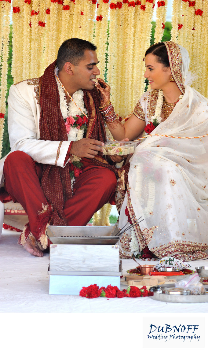 Bride feeding Groom at a San Francisco Bay Area Indian Wedding