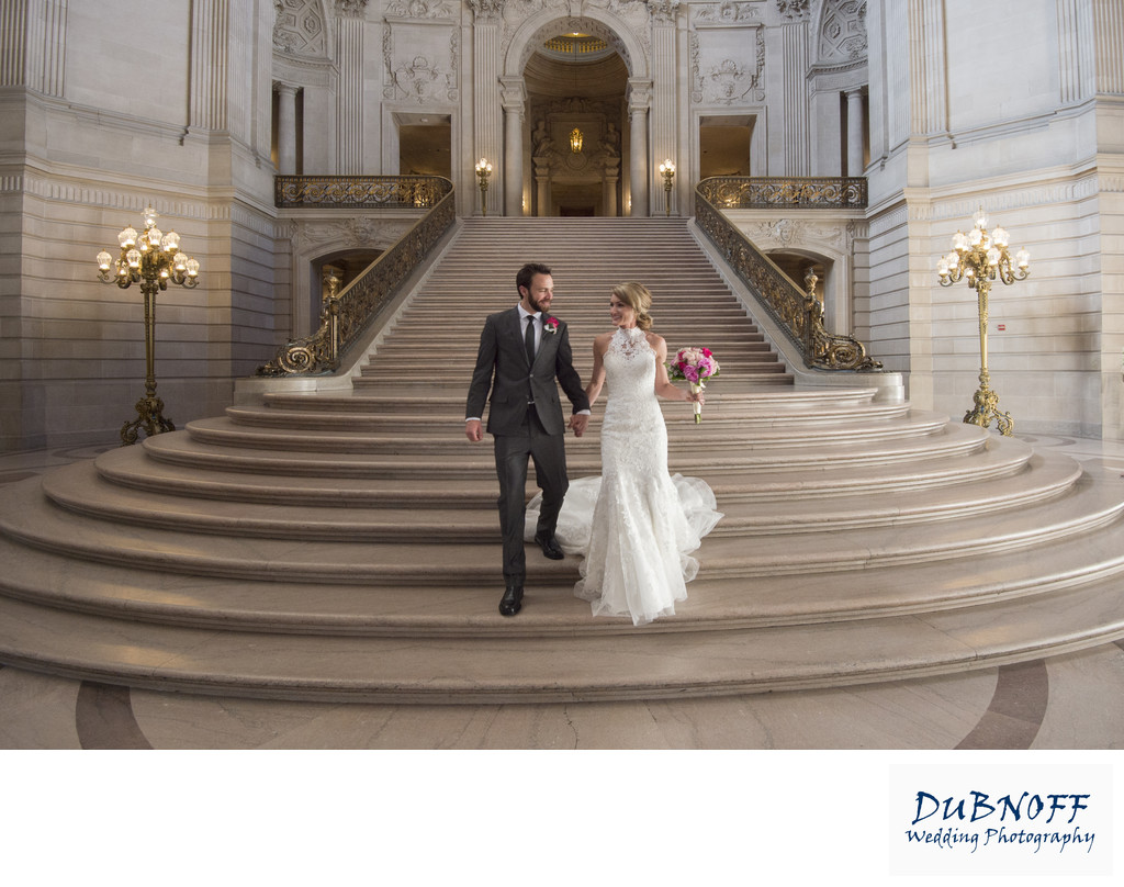 Bride and Groom walking the Grand Staircase at City Hall