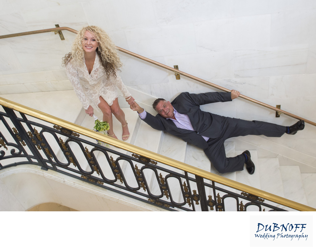 Fun San Francisco City Hall Wedding Photography on stairs
