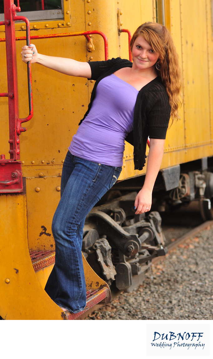 Portrait of High School Girl hanging off a train in Sacramento