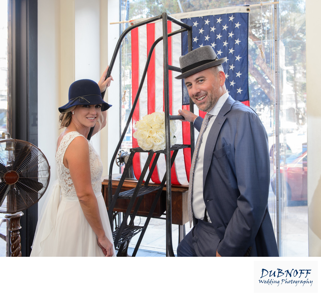 Bride and Groom having fun at the North Beach Hat Shop
