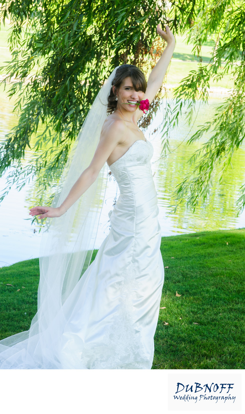 bride with rose in mouth in the San Francisco Bay Area