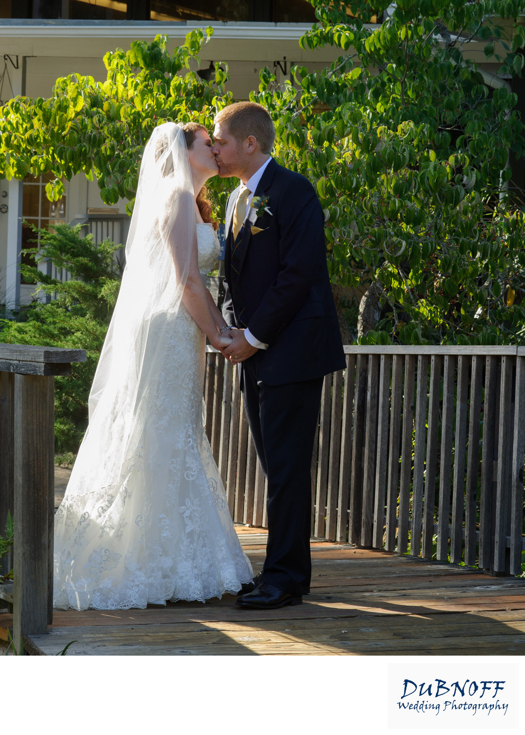 ceremony kiss in Marin County with bride and groom