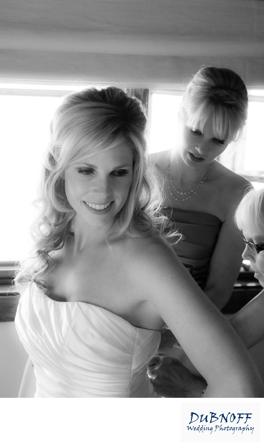Candid Wedding Image, Zipping the Dress